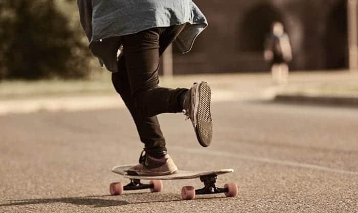 longboard-pushing